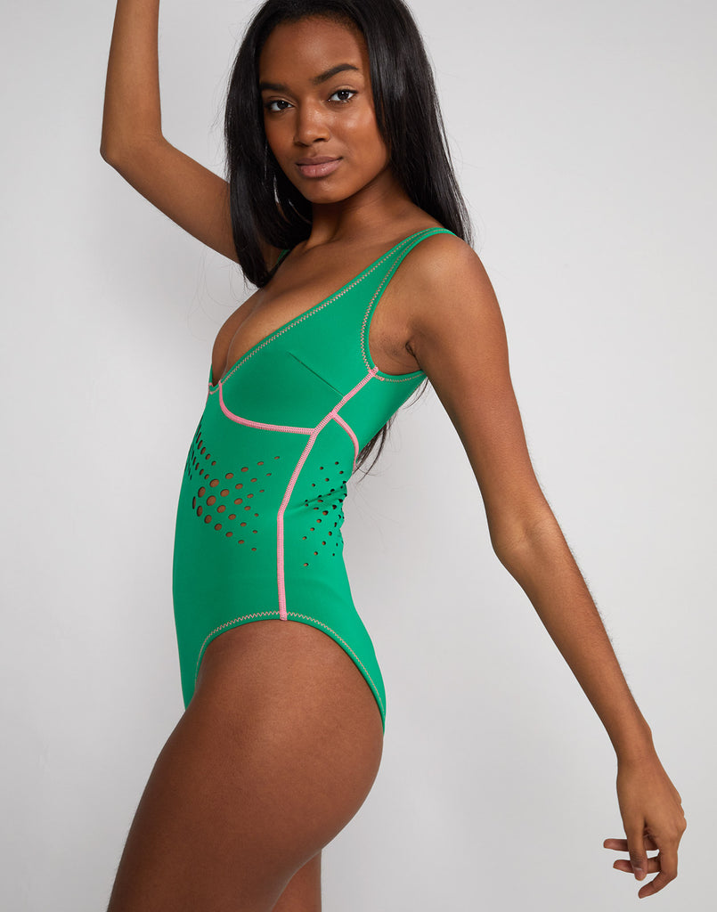 Side view of model wearing Maui perforated swimsuit.