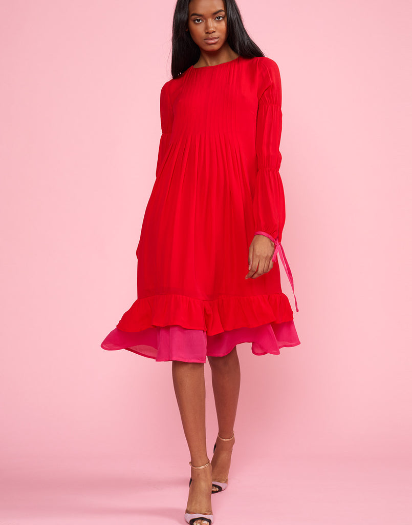 Full view of model wearing Isla Pinktuck Dress in cherry red.