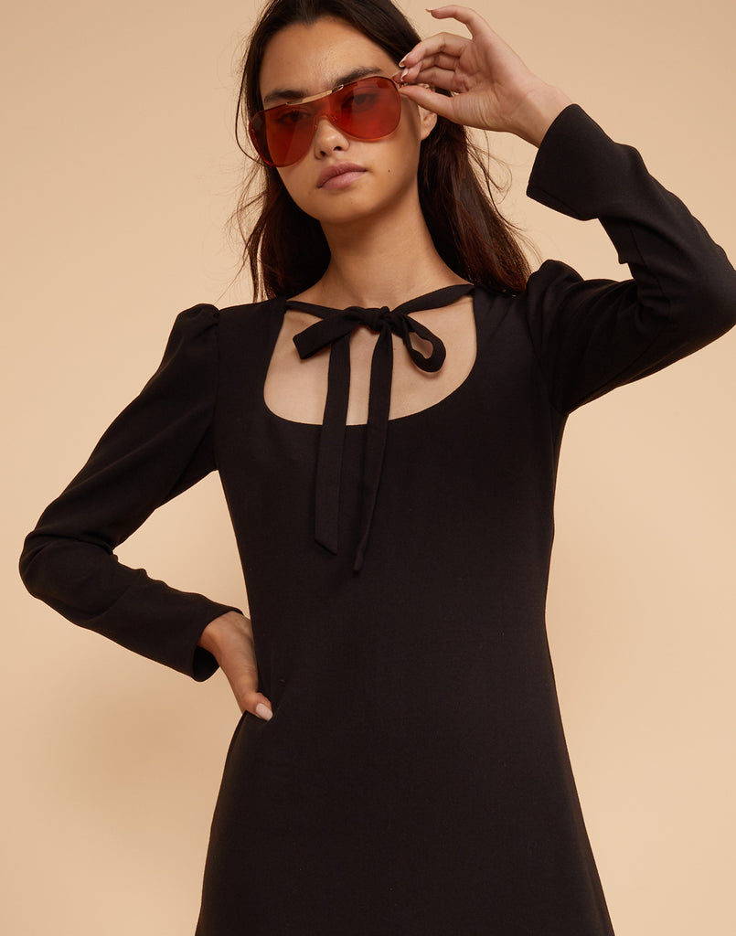 Close front view of the Waverly neck tie dress in solid crepe worn with sunglasses.
