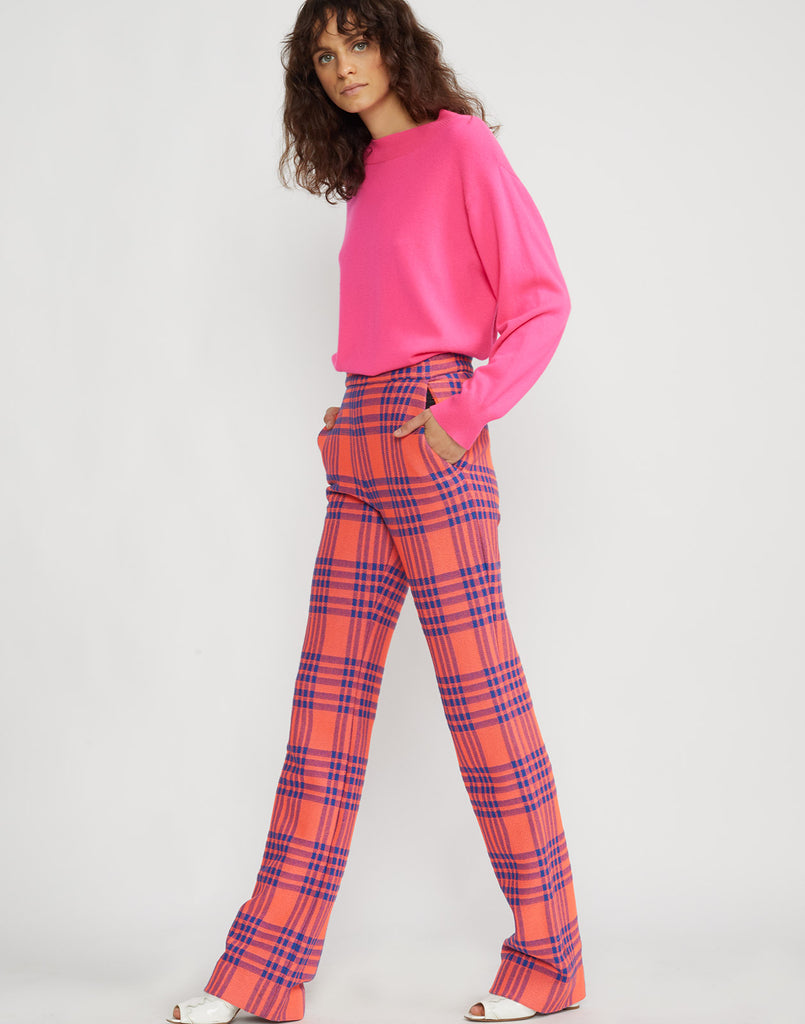 Full view of model wearing Carson stretch plaid pants.