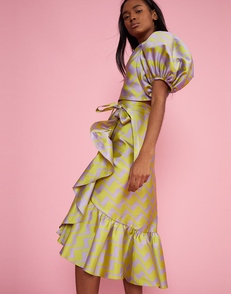 Alternate side view of the Evanston Brocade Zig Zag Skirt in lavender and lime with ruffle along the bottom and side