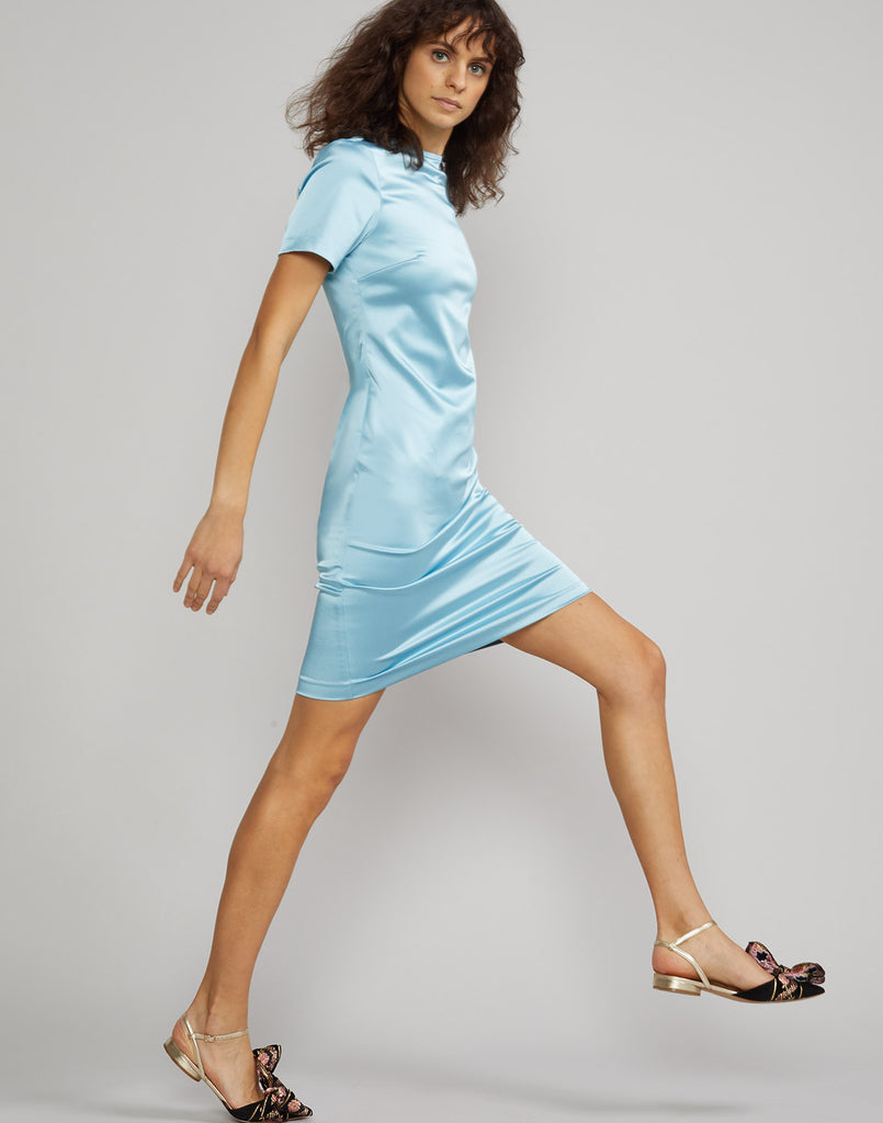 Side view of model wearing Lake Shore stretch satin t-shirt dress.