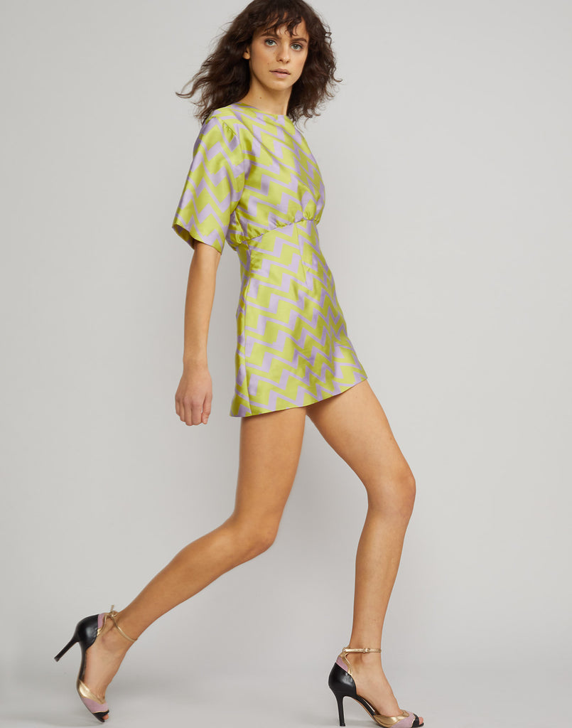 Full side view of the Evanston Zig Zag Brocade Mini Dress in lavender and lime