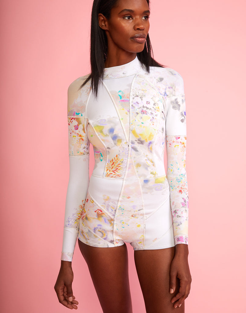Front view of full performance neoprene wetsuit in pastel floral print.