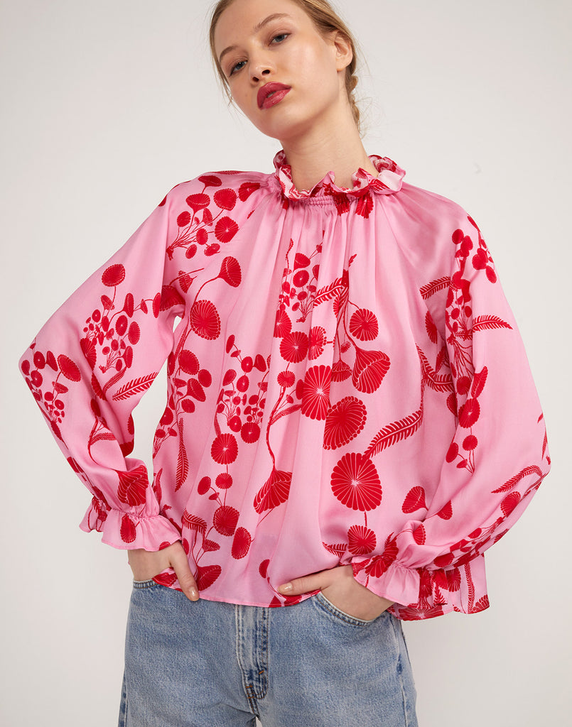 Full close up view of model wearing Poppy Smocked Ruffle Top.
