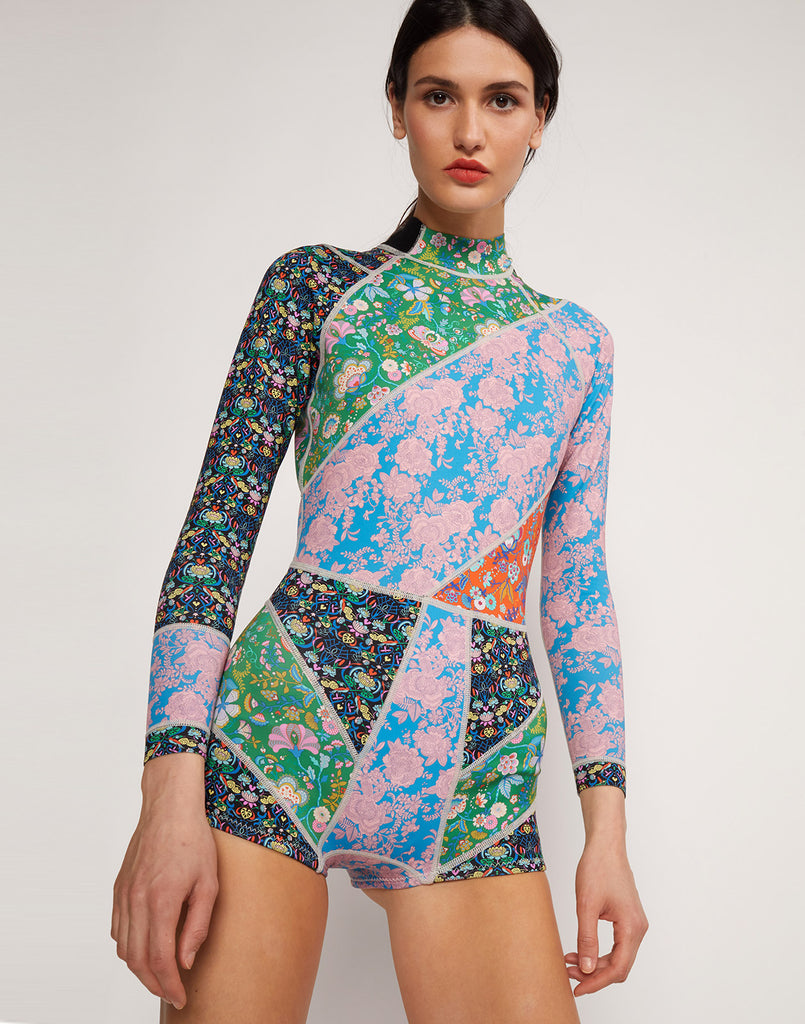 Close up view of model wearing Daybreak Floral Wetsuit.