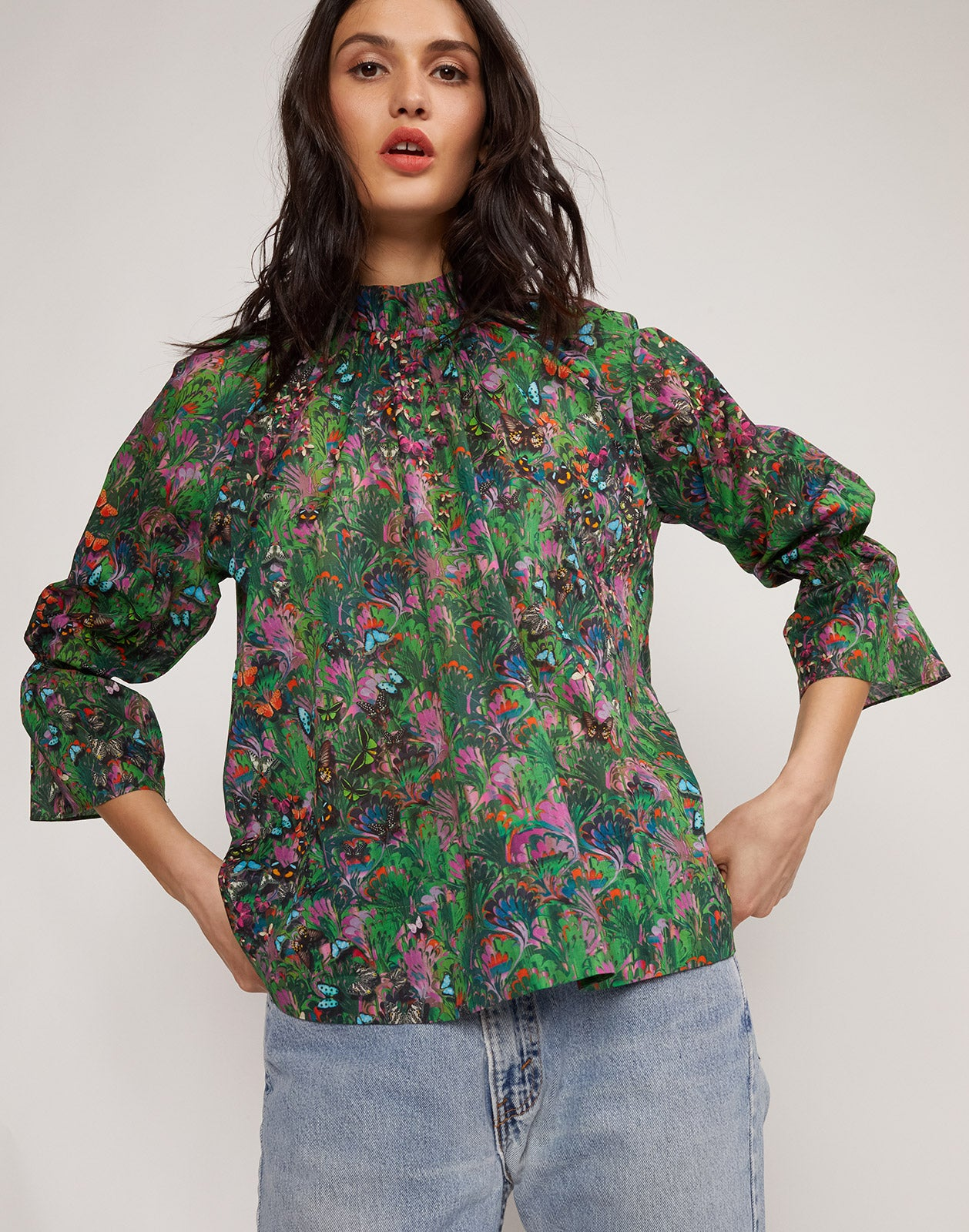 Close up view of model wearing Butterfly Cotton Waterfall Blouse.