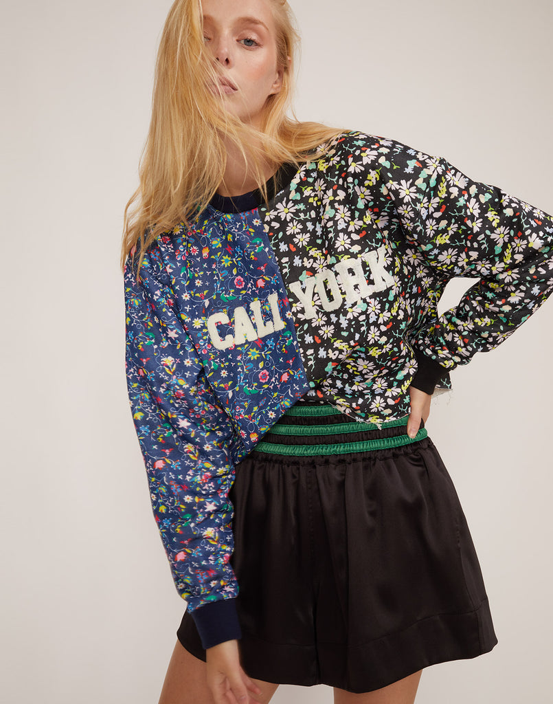 Front view the CRxBandier floral print cropped sweatshirt with CaliYork embroidery.