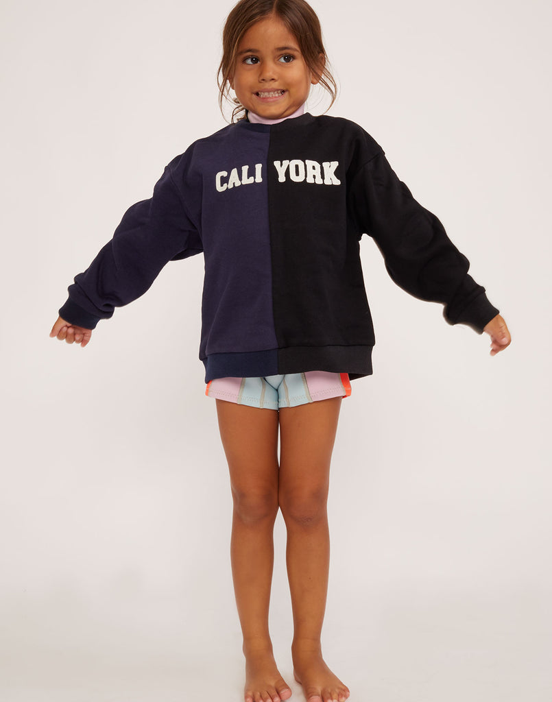 Model wearing the Kid's CaliYork cotton sweatshirt in navy and black.