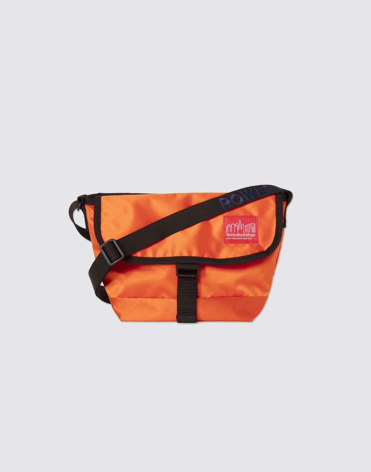 Front detail shot of Blood Orange Mini Manhattan Portage Messenger Bag with front buckle and arm strap.