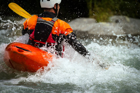 A kayaker makes his way down a whitewater rapid.