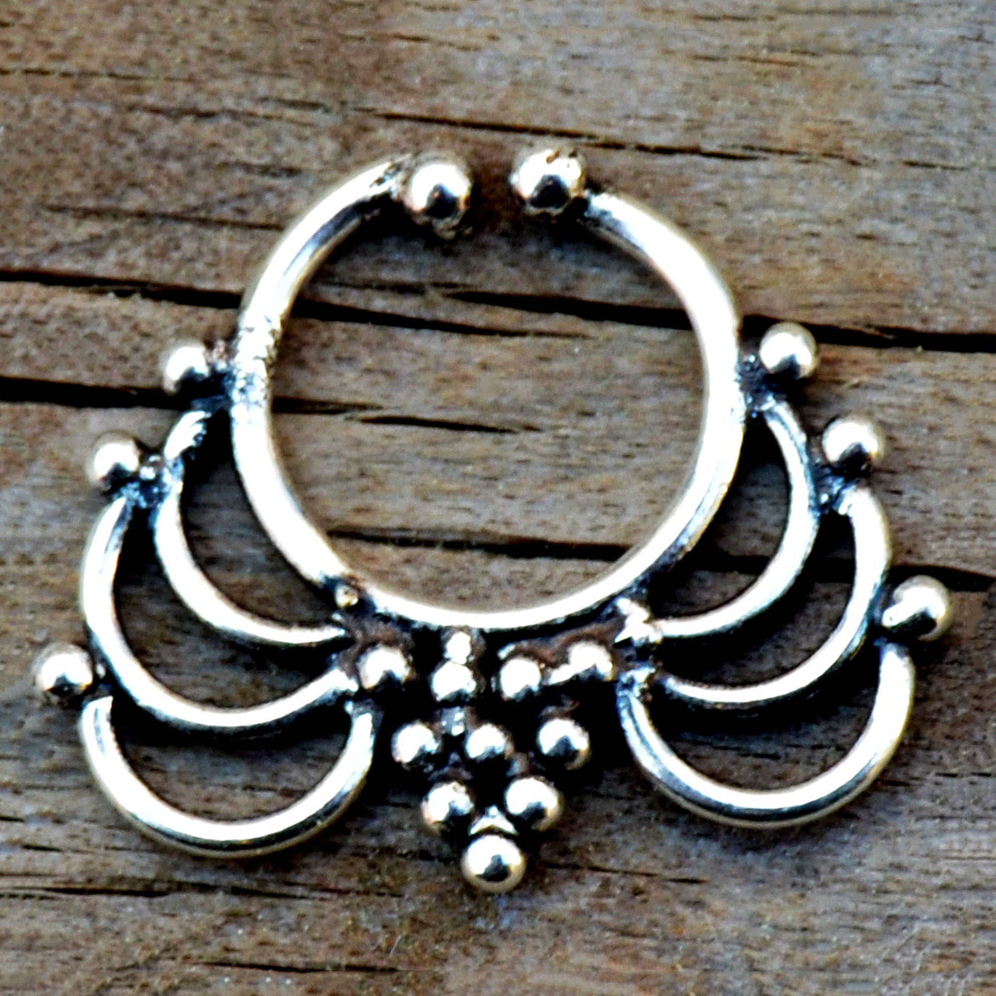 Ormate silver fake nose ring