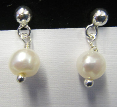 Sterling Silver pearl earrings, approximately 2 cm in length