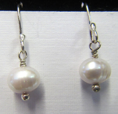 Sterling Silver pearl earrings, approximately 2.5 cm in length