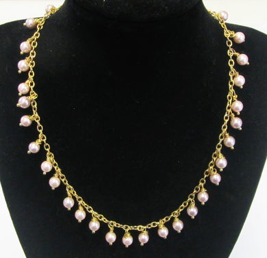 Beautiful handcrafted pink shell pearl necklace with clip clasp