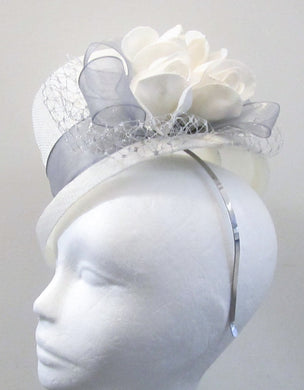 Handcrafted white bridal top hat fascinator with silver ribbon, netting and roses on a hair band