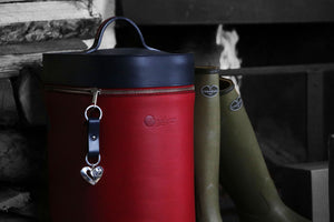 Tall leather boot bag holding Le Chameau boots.