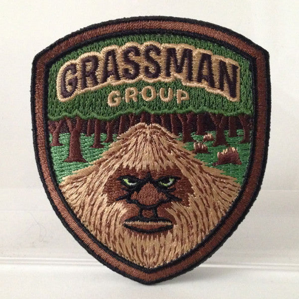 Grassman Group embroidered patch