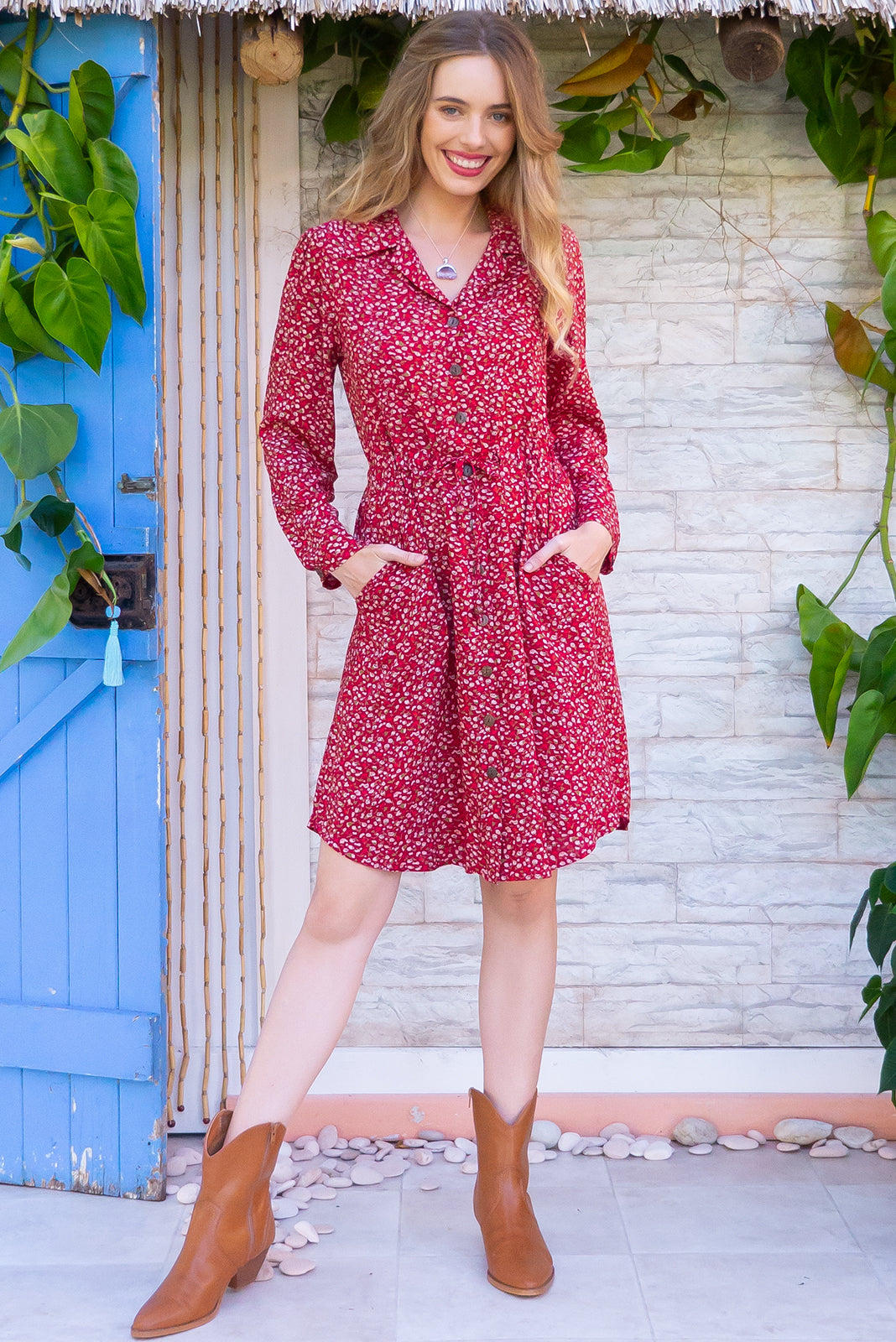 Alexandra Redcurrant Shirt Dress features a functional button front, long sleeve, drawstring waist and chic collar and it comes in a strong red ditzy floral print on 100% rayon