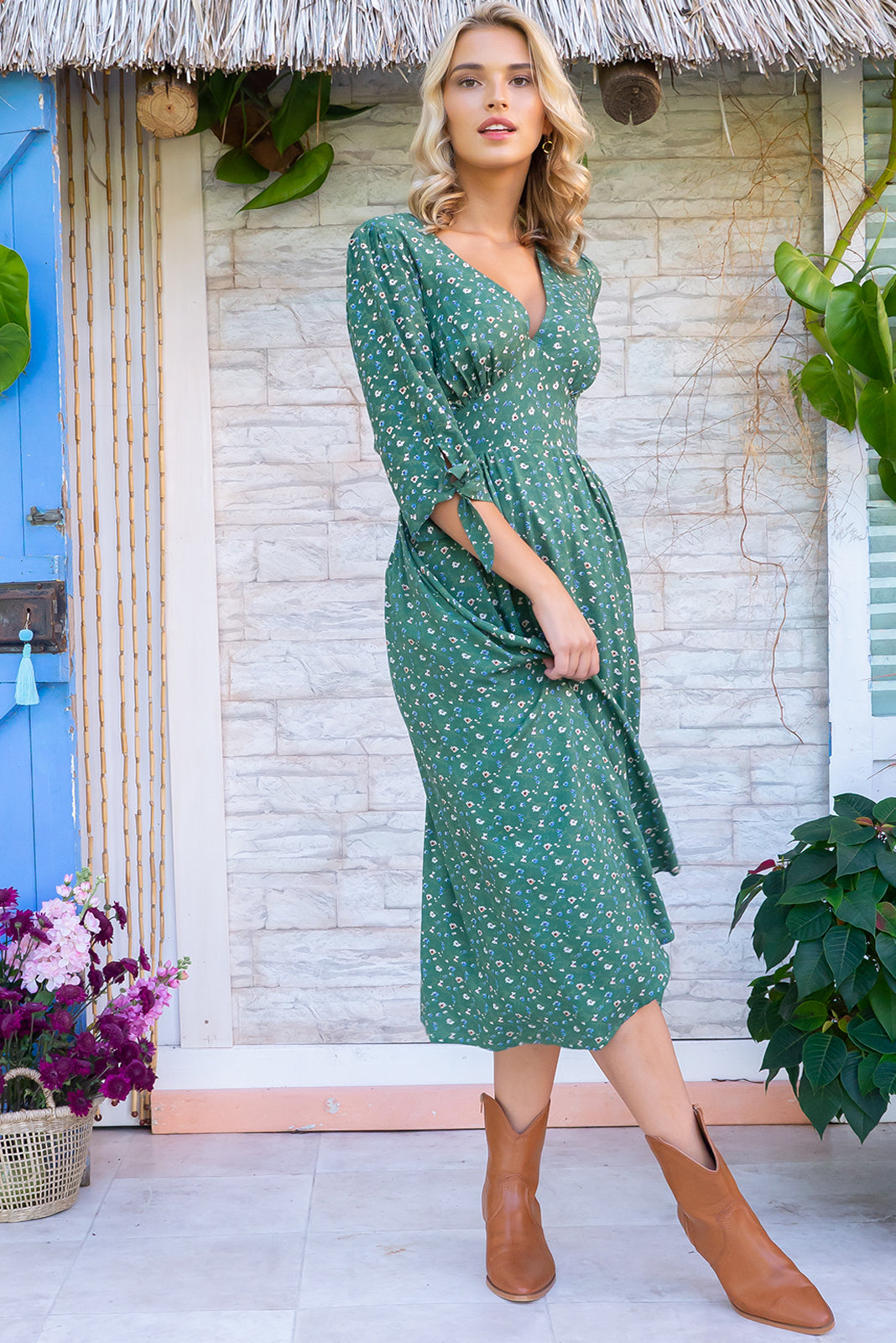 Henrietta Field Flowers Midi dress features a vintage inspired fitted basque waist and elasticated waist with a midi sleeve and deep v neck the fabric is a soft woven rayon in a soft green ditzy floral print design