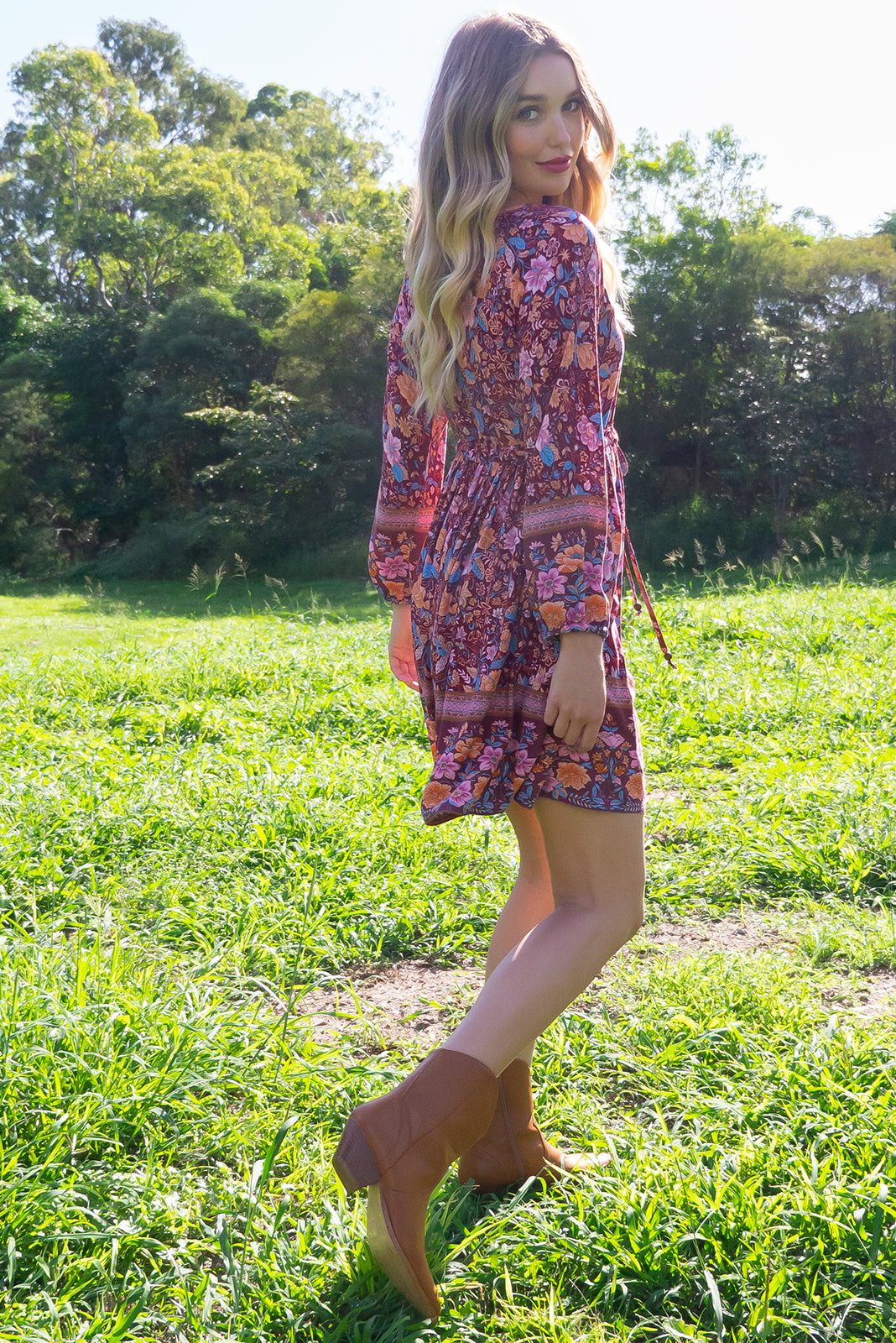 Jennifer Rosewood Dress with a button front, long sleeve with elastic at the wrist, side pockets and a full skirt in a wine red tonal bohemian floral border print on a 100% woven rayon chic and effortless style