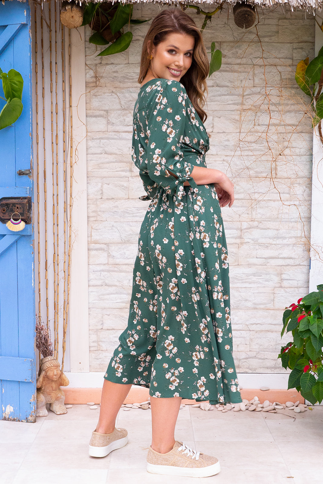 Judith Green seasons Midi dress features a vintage inspired fitted basque waist, elasticated waist with a midi sleeve, deep v neck and fully functional button front in a soft woven rayon fabric with a bohemian romantic floral bohemian print on a soft forest green base