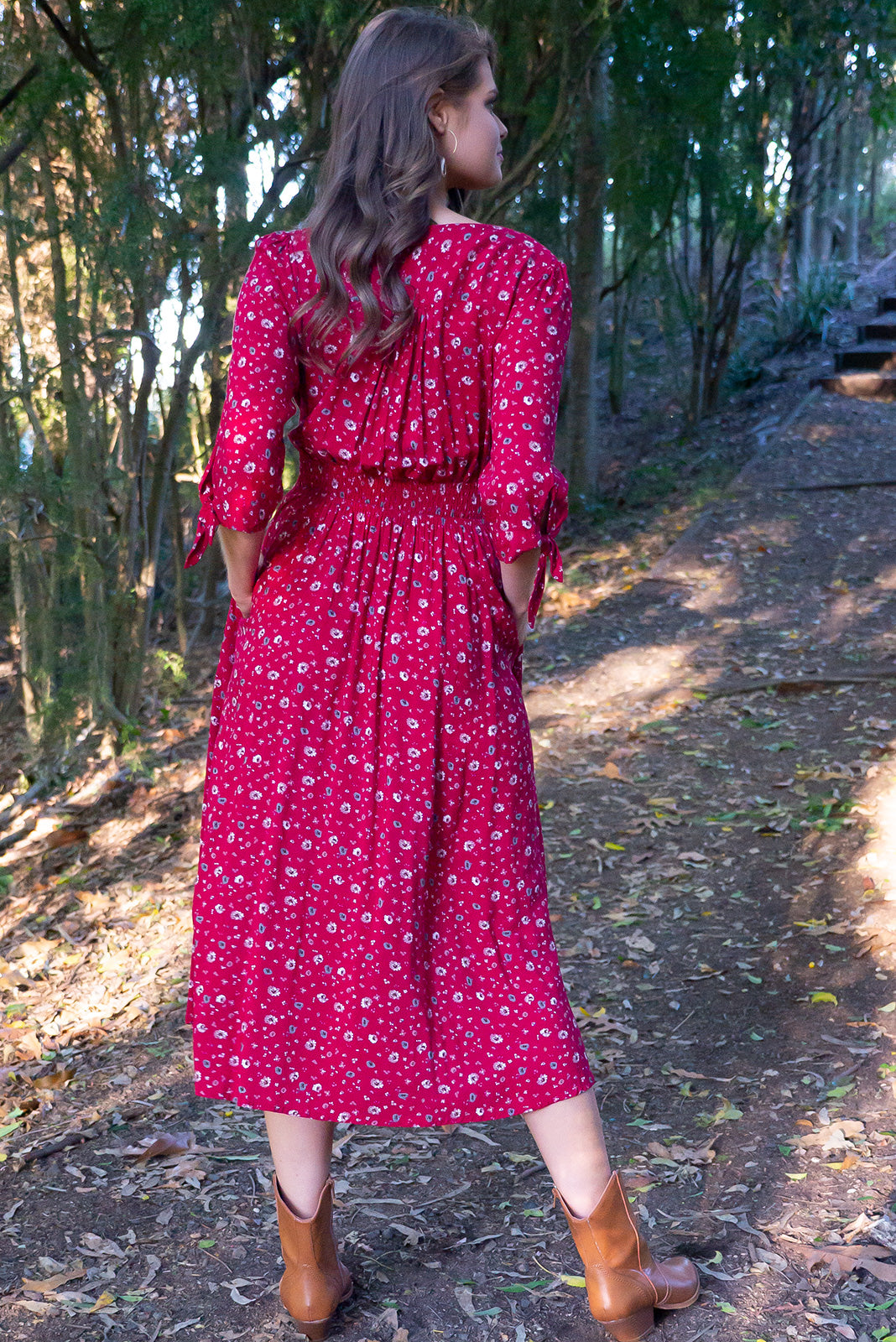 Judith Red Rea Dress vintage inspired classic cut. Midi length, complete button down red dress, 3 quarter sleeves. Deep red fabric featuring roses pattern.