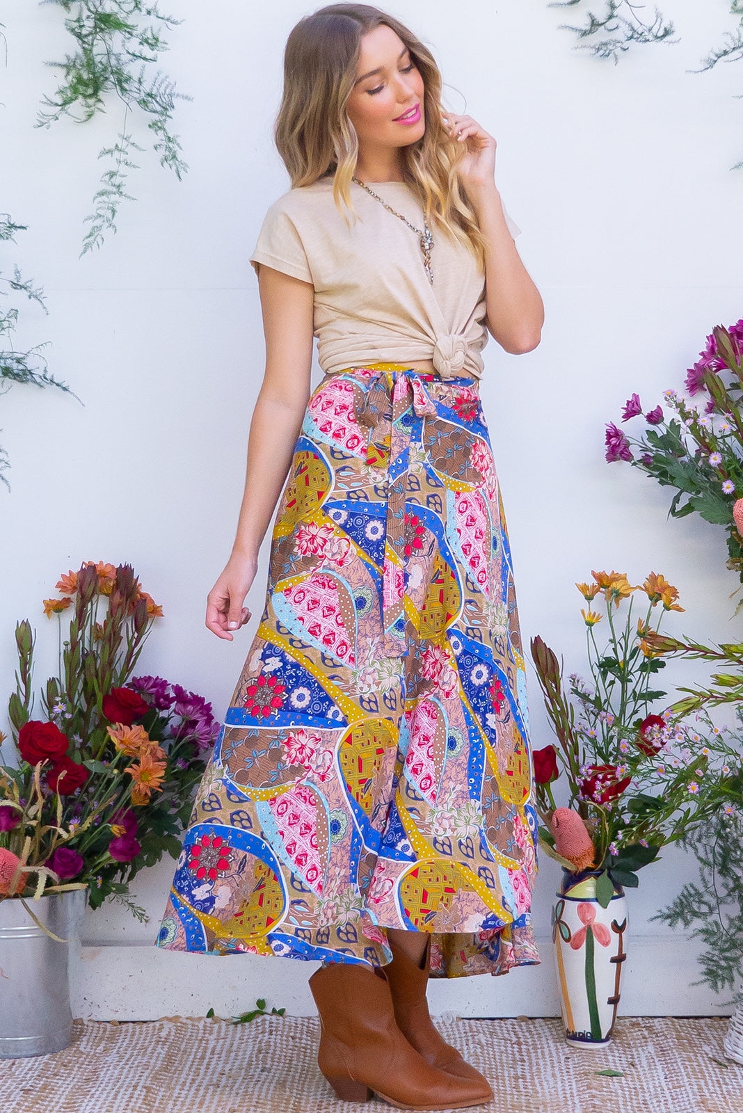 Penny Lane Boho Patches Maxi Wrap Skirt with an adjustable wraparound waist and waterfall hemline in a soft woven rayon with a bright bohemian  patchwork print