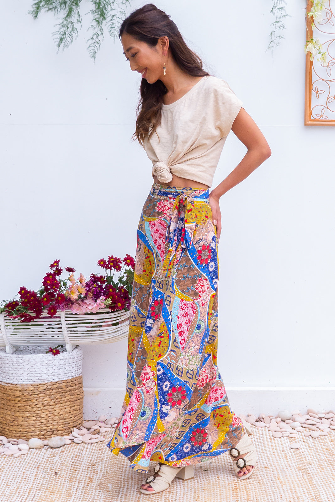 Penny LaneGypsy Patches Maxi Wrap Skirt with an adjustable wraparound waist and waterfall hemline in a soft woven rayon with a bright bohemian  patchwork print