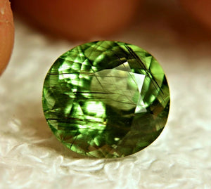 7.63 Carat Rutilated Peridot, Horse Hair Inclusions, Deep Green