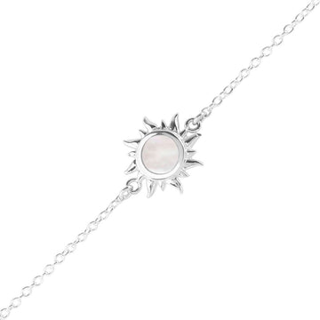 Silver chain bracelet with sun charm with round mother of pearl inlay in the center
