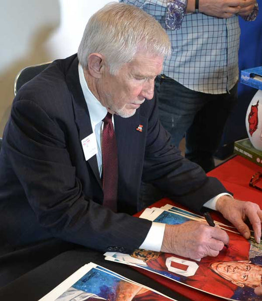 Loyd Phillips signing official Texas Sports Hall of Fame print by Robert Hurst