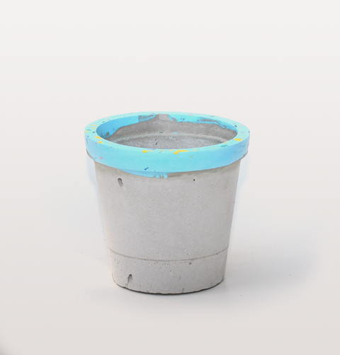 Concrete Candy, hand made concrete and Jesmonite. Terrazzo effect speckles with pink, yellow, green and turquoise blue rim. Succulent planter or flower pot.