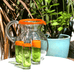 MEXICAN CLEAR ORANGE GLASS JUG BY MILAGROS WITH GREEN AND ORANGE TEQUILA SHOT GLASSES
