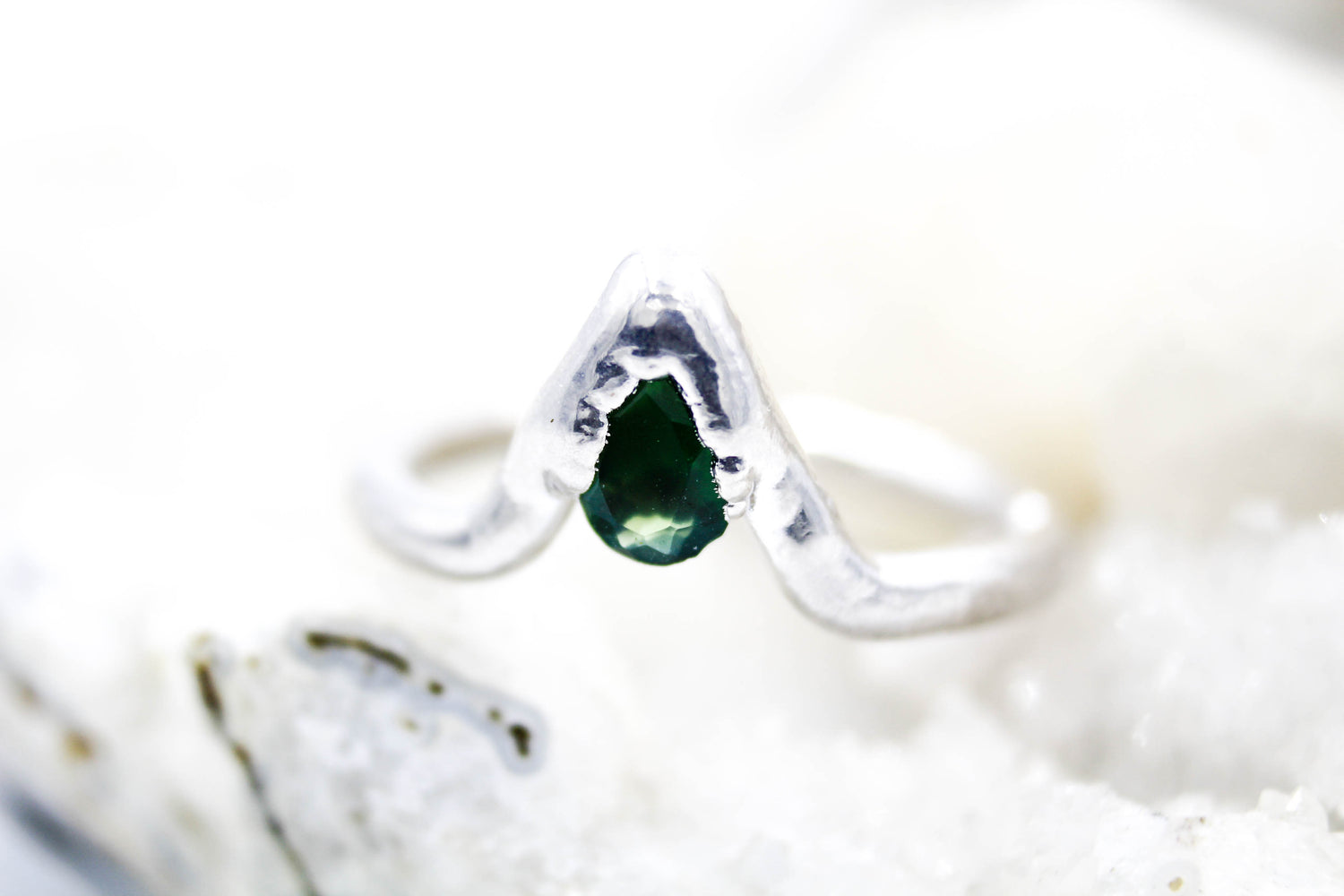 Emerald engagement ring with gemstones by Fox & Stone