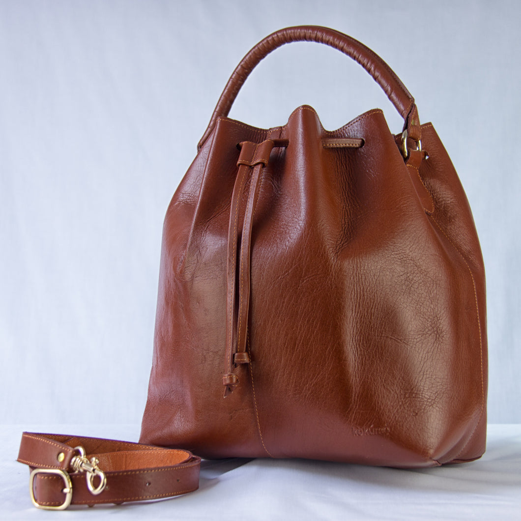 Brown Dodo bucket bag with handle and adjustable strap