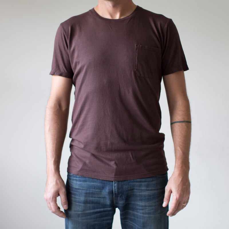 angle: walnut  A model wears Raleigh Denim Workshop cotton/modal pocket crew neck tee in brown walnut
