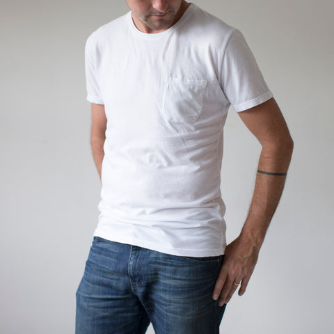 angle: white | A model wears Raleigh Denim Workshop cotton/modal pocket crew neck tee in white