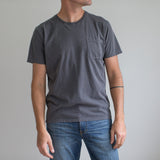 angle: charcoal  A model wears Raleigh Denim Workshop cotton pocket crew neck tee in charcoal, front view