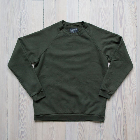 angle: dark moss| A Raleigh Denim Workshop sweatshirt in dark moss