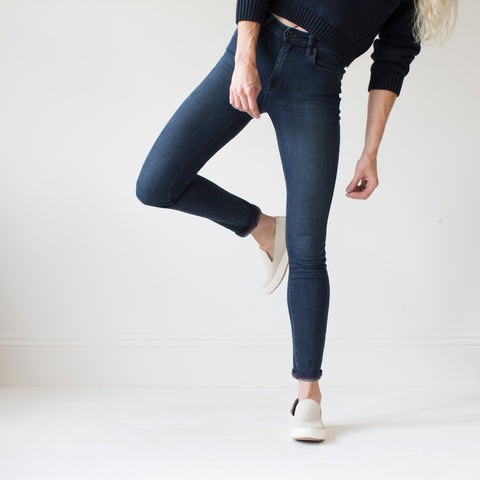 angle: canon | A model wears Raleigh Denim Workshop Haywood high-rise skinny jeans with a dark wash, front view