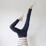 angle: indigo  A model wears Raleigh Denim Workshop Haywood high-rise skinny jeans in dark blue, upside-down view