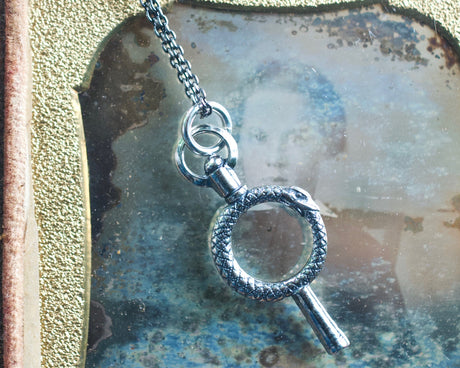 ouroboros watch key necklace charm