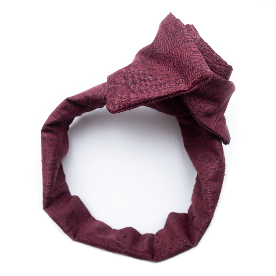 handmade wide cut headband with wire frame and square ends in wine colored summer fabric.