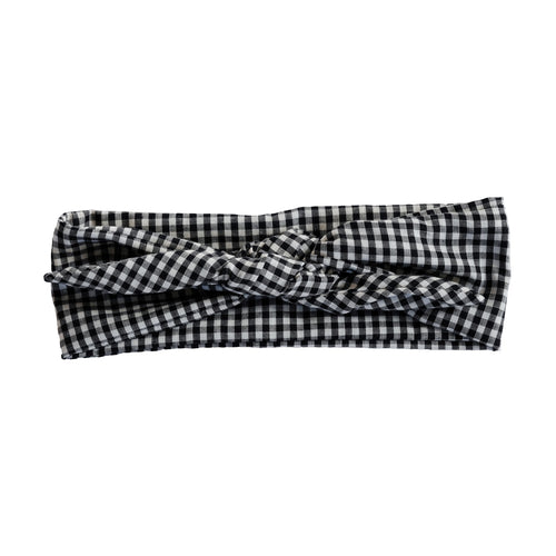 Overview of black and white gingham wire-framed bandana tied in a bow. Stylish headache free head wrap. 36 inches long by 2.5 inches wide wired hair scarf. 50s and 60s, classic, rockabilly, pinup style, adjustable bandanna. Painless hair accessories. Bohemian, vintage, classic, old hollywood head wrap. Sculptural, adjustable hair accessories. Summery, beachy, minimalist hair accessory.