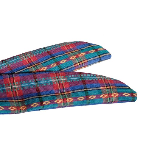 Overview of the tapered ends of a blue, teal, pink, and yellow woven plaid headband on white background. Knit wire framed head wrap. Adjustable headscarf. Headache free wired hair accessory. 31 inches long by 1.5 inches wide wire framed hair scarf. Rockabilly pinup 50s 60s style headband. Madras plaid.
