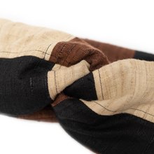 Detail photo of luxurious khadi black, brown, and beige patchwork wire headband.