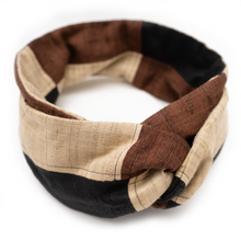 Overview of luxurious khadi black, brown, and beige patchwork wire headband.