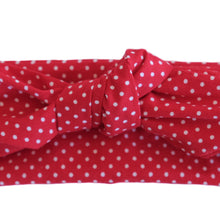 Closeup overview of a red wire-framed bandanna with white polka dots. 36 inch long by 3 inch wide, thick, red and white, headache free, wired headband. Painless hair accessory. Hair scarf.