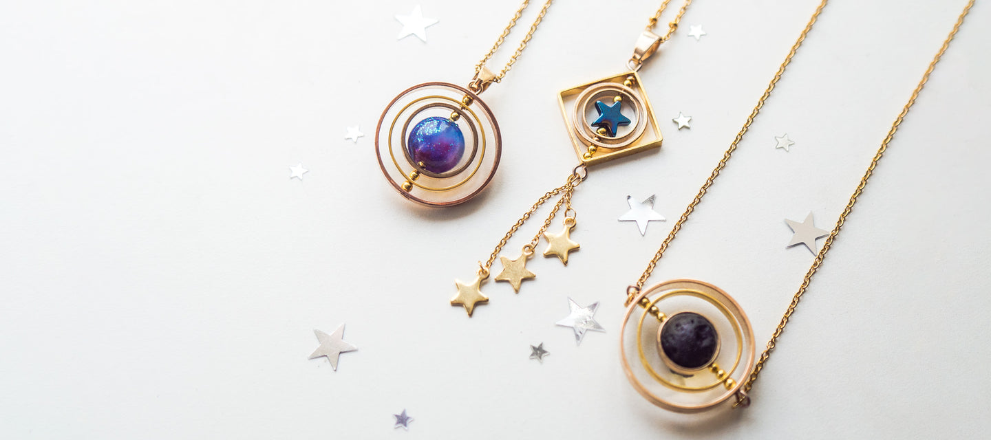 Space and galaxy inspired spinner necklaces | 13th psyche